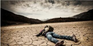 Man dying in a baking hot desert