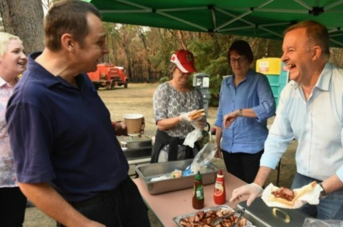 Anthony Albanese serving sausages