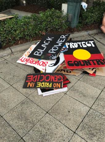 dumped signs at invasion day rally