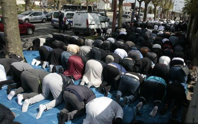 Muslims praying after takeover of areas of Paris