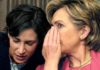 Hillary Clinton whispering to aide