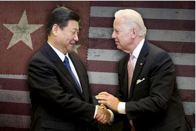 Joe Biden shakes hands with Xi Jinping