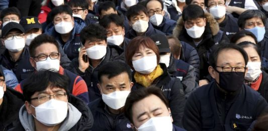 Asians wearing masks in a crowd