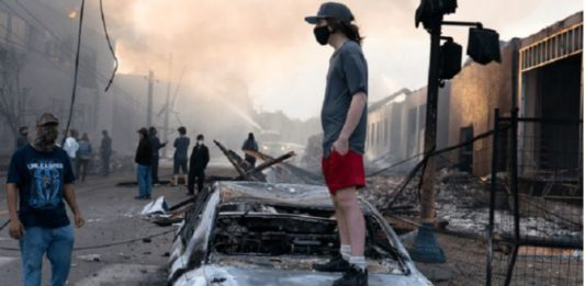 Anarchist on a burned out car